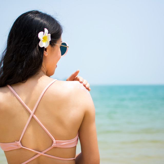 """Girl applying sun lotion on summer vacation"" stock image"