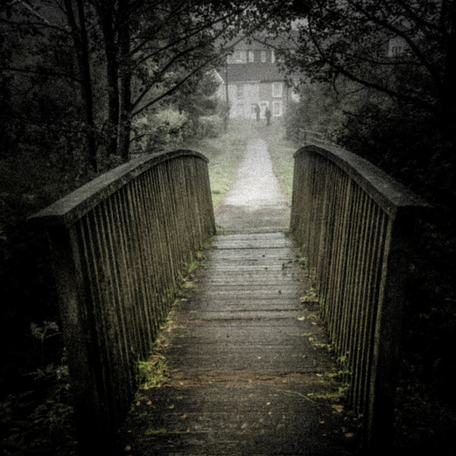 """Figures approaching wooden bridge."" stock image"