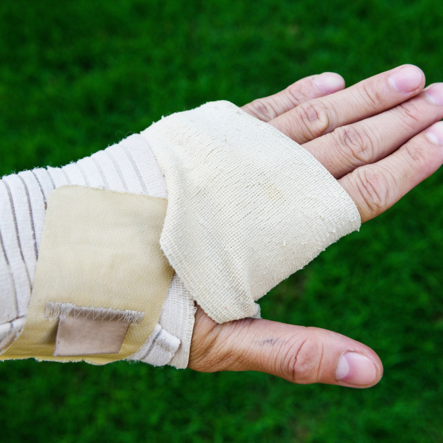 """hand covered by medical bandage"" stock image"