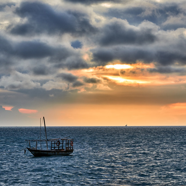 """dhow swings in sea at sunset"" stock image"