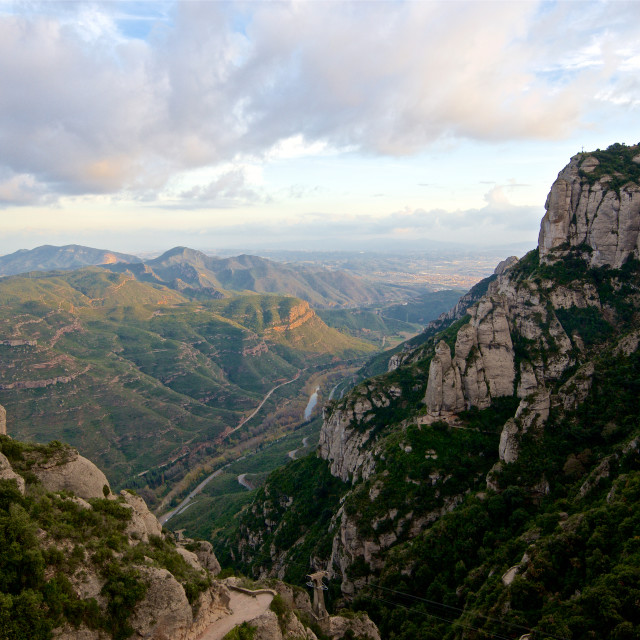 """Scenic view of a rivery valley on a stormy day in Spain"" stock image"