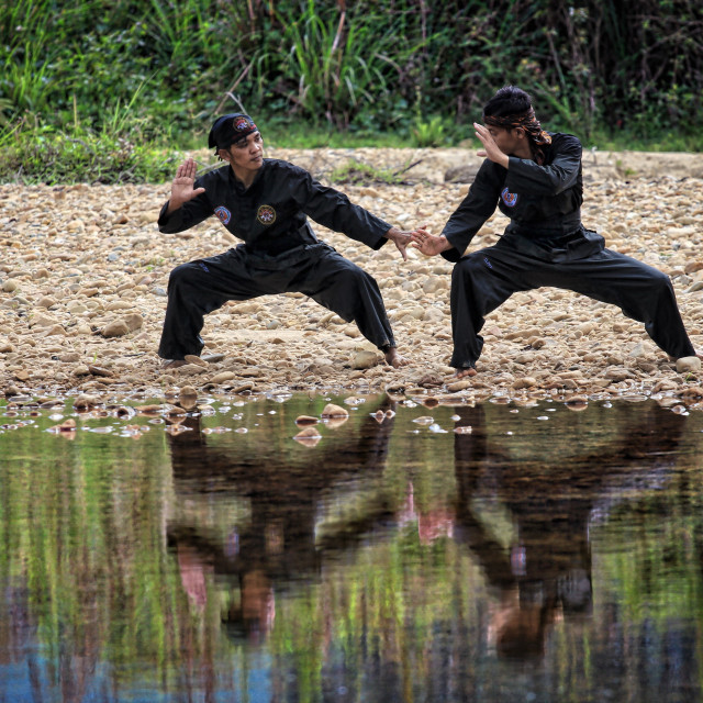 """Martial art known as silat by two martial art practitioners"" stock image"