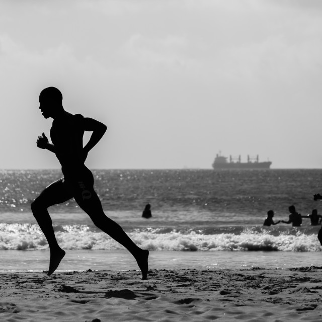 """Beach Lifeguards Running Silhouetted"" stock image"