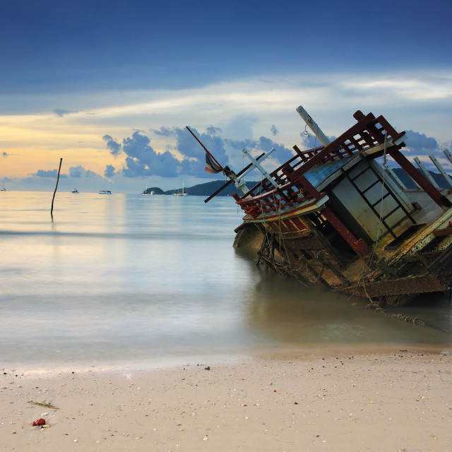 """Seascape with Wreck ship at sunrise"" stock image"