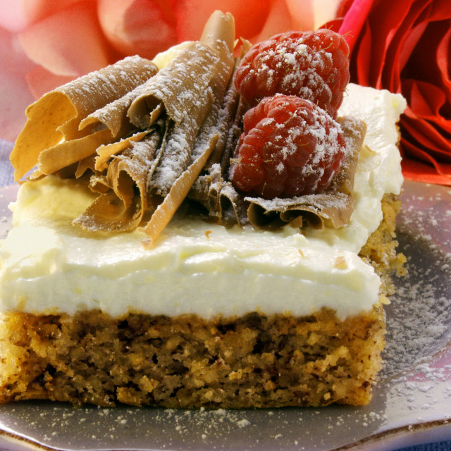 """Nut cake with mascarpone, chocolate curls & raspberries"" stock image"