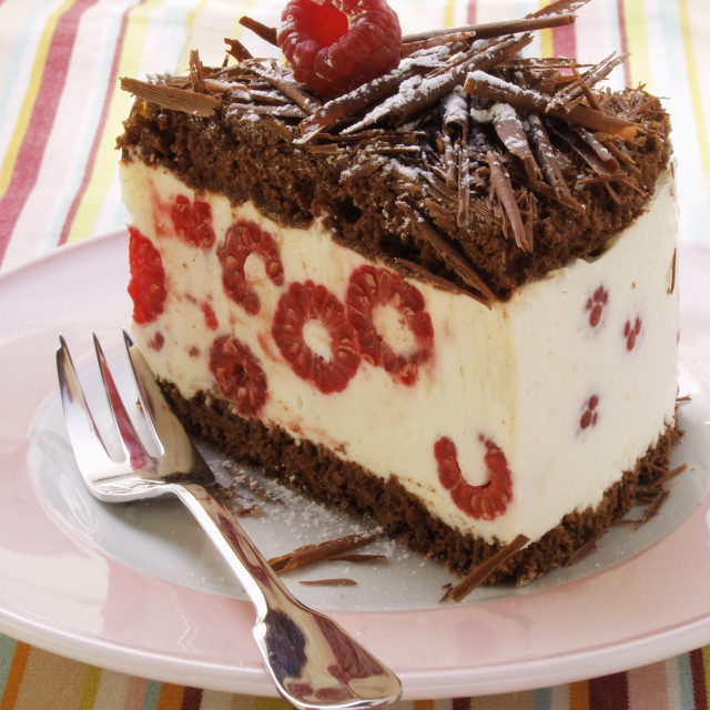 """A piece of chocolate raspberry gateau with chocolate curls"" stock image"