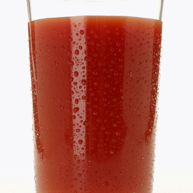 """""""Tomato juice in glass with drops of water"""" stock image"""