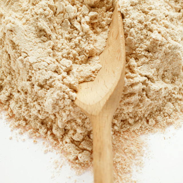 """""""Wholemeal flour with wooden scoop"""" stock image"""