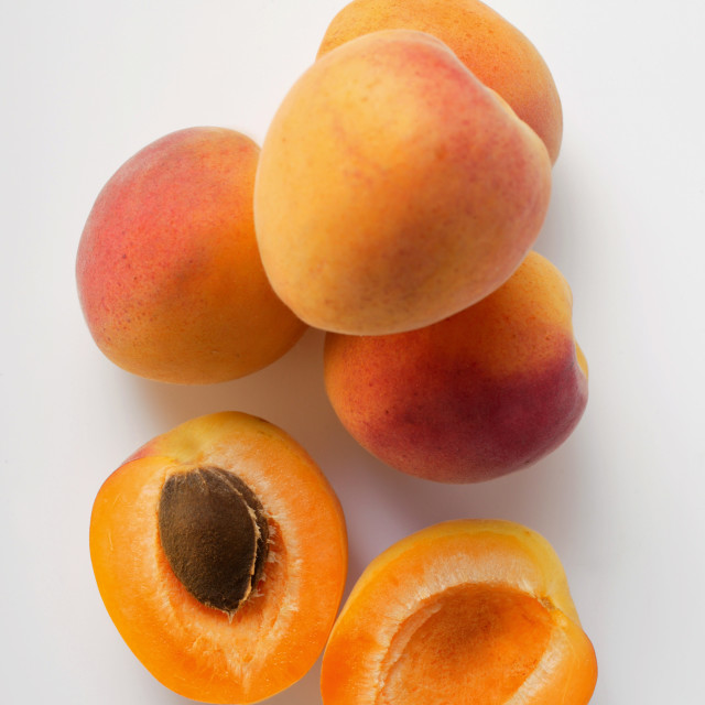 """""""Apricots, one halved"""" stock image"""