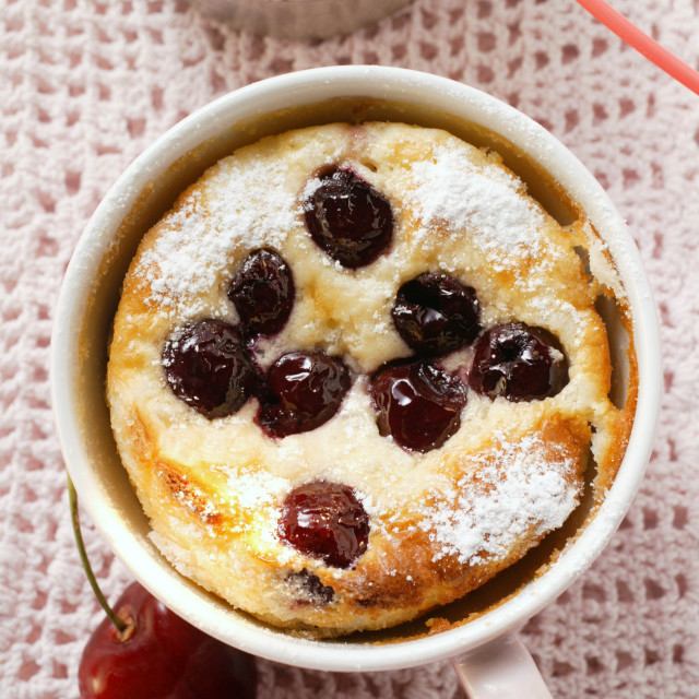 """""""Quark and semolina pudding with cherries and icing sugar in cup"""" stock image"""