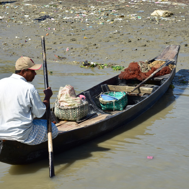 """""""Fisherman and his boat"""" stock image"""
