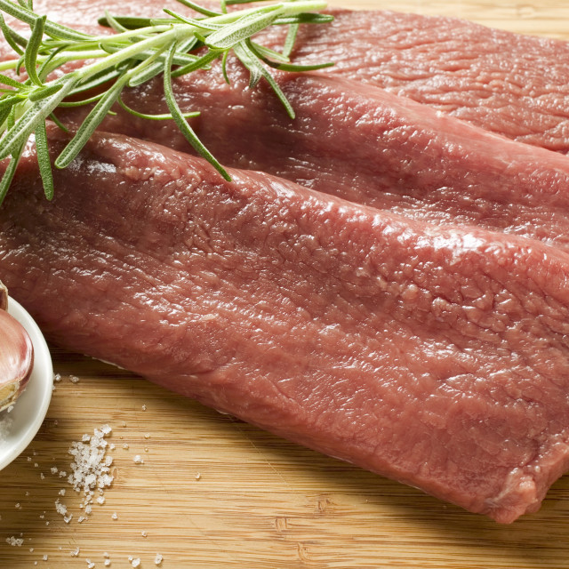 """""""Veal escalopes with salt, garlic and rosemary"""" stock image"""