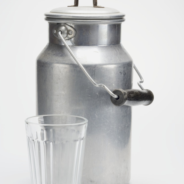 """""""A milk can and an empty glass"""" stock image"""