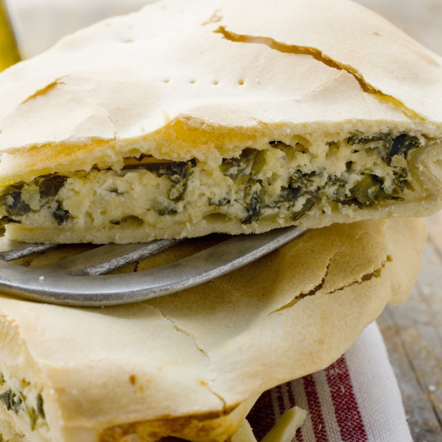 """""""Spinach and ricotta pie (one piece on spatula)"""" stock image"""