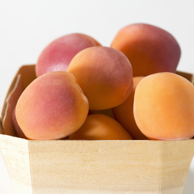 """""""Several apricots in woodchip basket"""" stock image"""