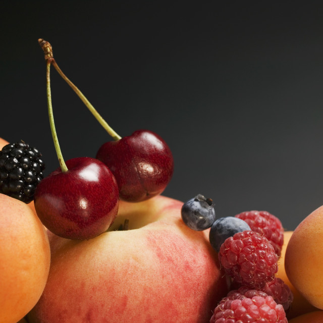 """""""Fruit still life with stone-fruit and berries"""" stock image"""