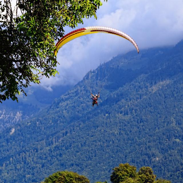"""Paragliders in Swiss Alps in Interlaken, Jungfrau Region"" stock image"