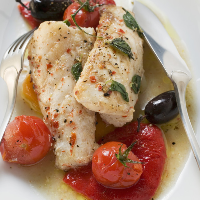 """Monkfish fillets with cherry tomatoes and olives"" stock image"