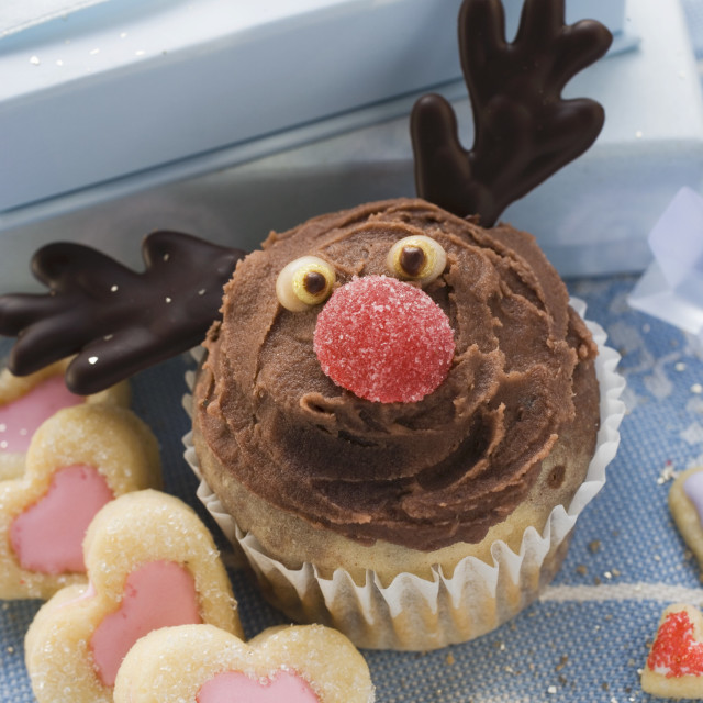 """Christmassy chocolate muffin and heart-shaped biscuits"" stock image"