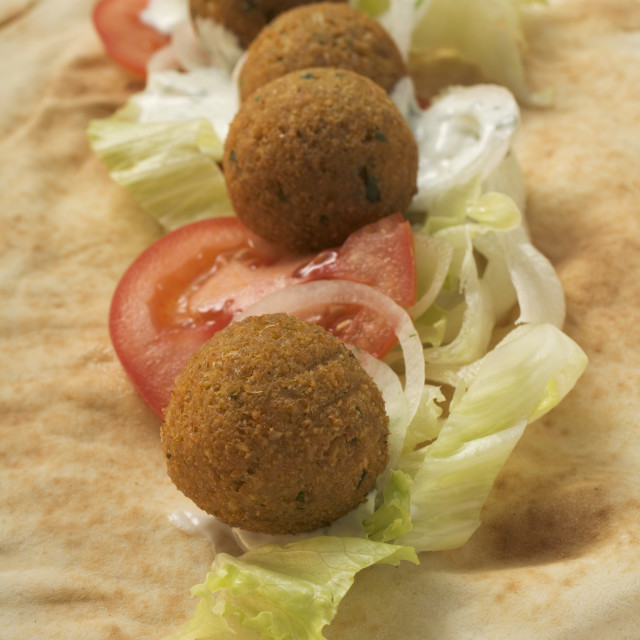 """Falafel (chick-pea balls) with vegetables on flatbread"" stock image"
