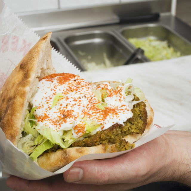 """Pita bread filled with falafel, lettuce and yoghurt"" stock image"