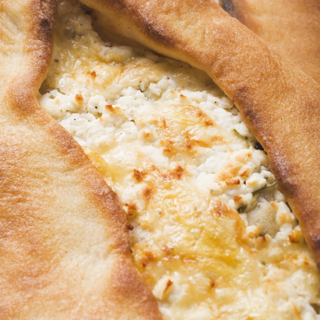 """""""Pide (Turkish flatbread) with sheep's cheese filling, close-up"""" stock image"""