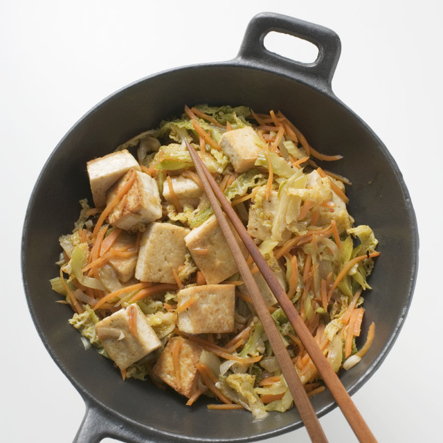 """Tofu with vegetables in wok (overhead view)"" stock image"