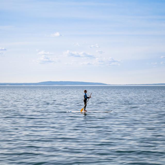 """""""Paddleboarding minimalism"""" stock image"""