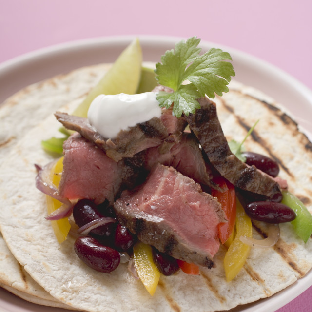 """Beef fajita with beans, peppers and sour cream"" stock image"