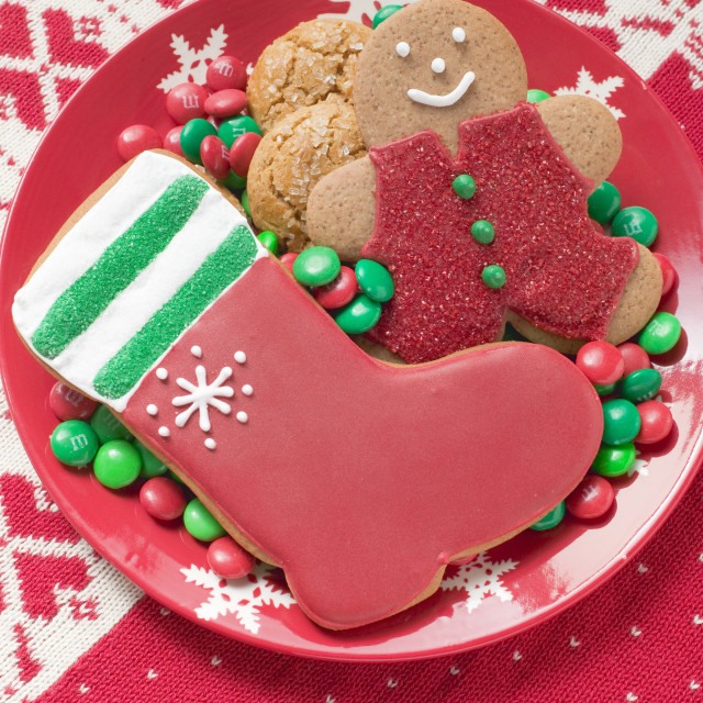 """Christmas biscuits and chocolate beans on plate"" stock image"