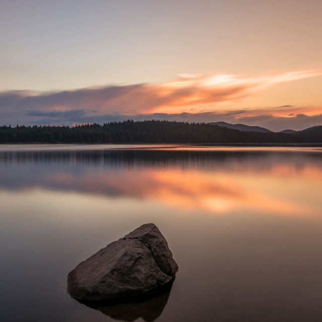 """Magnificent long exposure lake sunset"" stock image"