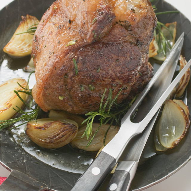 """""""Veal loin steak with onions and rosemary in frying pan"""" stock image"""