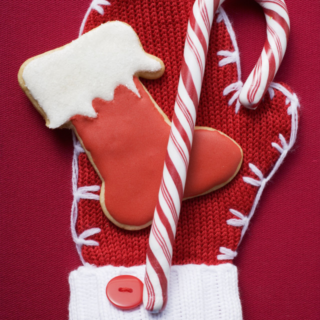 """""""Boot biscuit and candy cane on woollen mitten"""" stock image"""