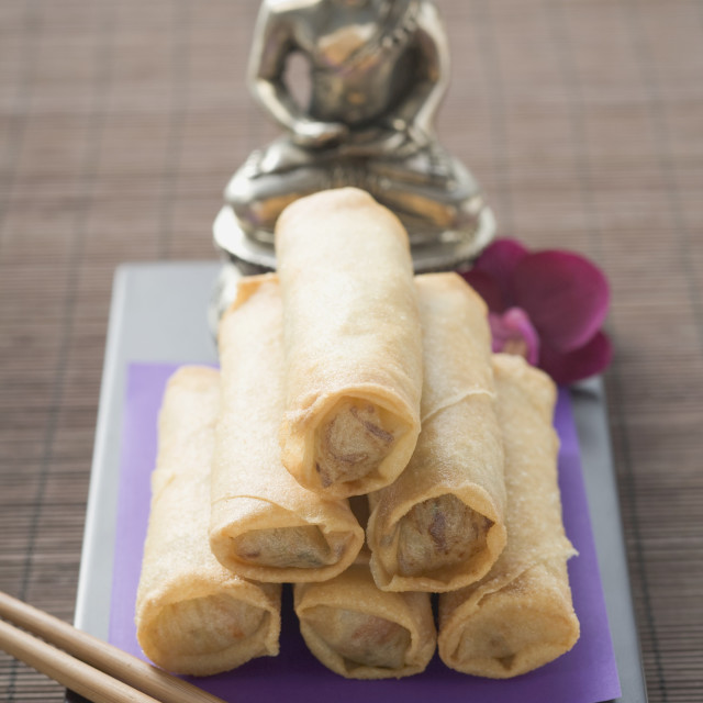 """""""Spring rolls in front of Buddha statue"""" stock image"""