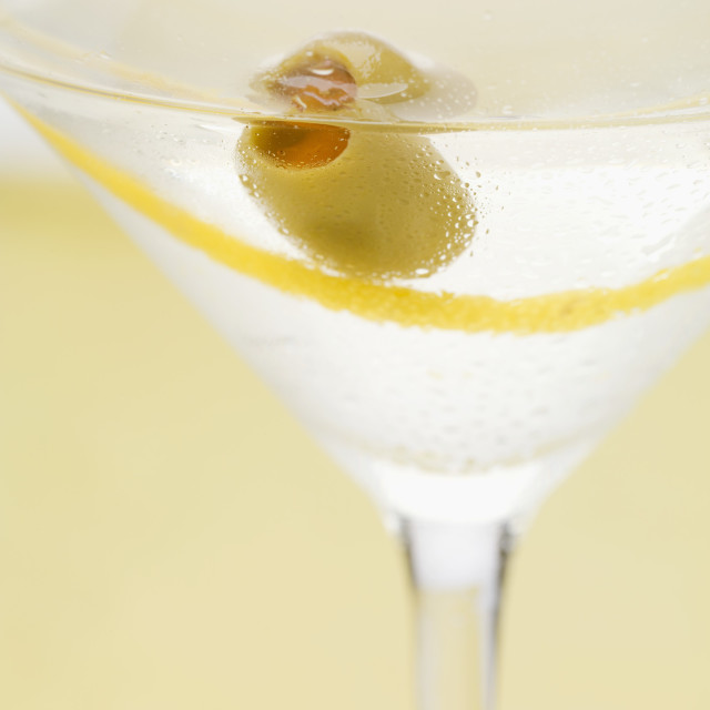 """Martini with olive and lemon zest (close-up)"" stock image"