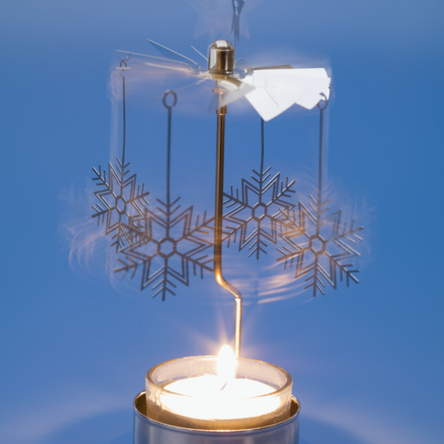 """Christmas mobile over tea light"" stock image"