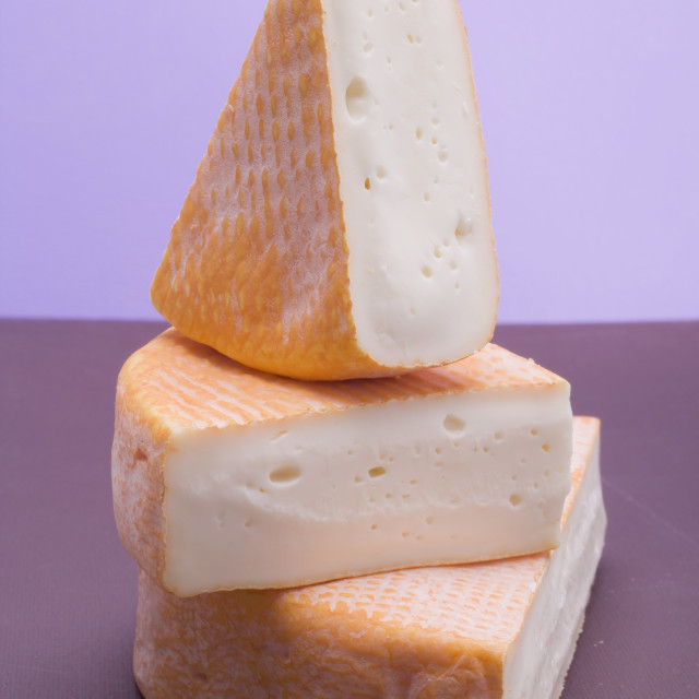"""Three pieces of washed-rind cheese"" stock image"