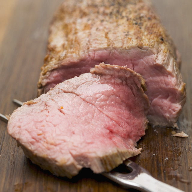 """""""Roast veal fillet, partially carved"""" stock image"""