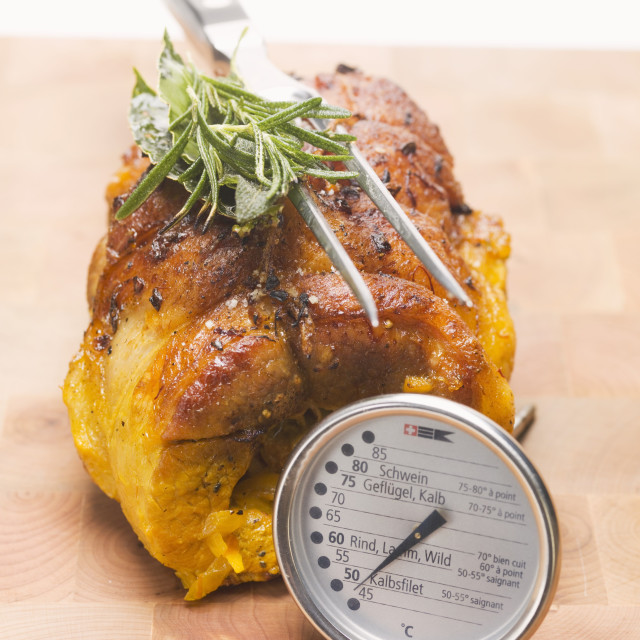 """""""Stuffed breast of veal with meat thermometer"""" stock image"""