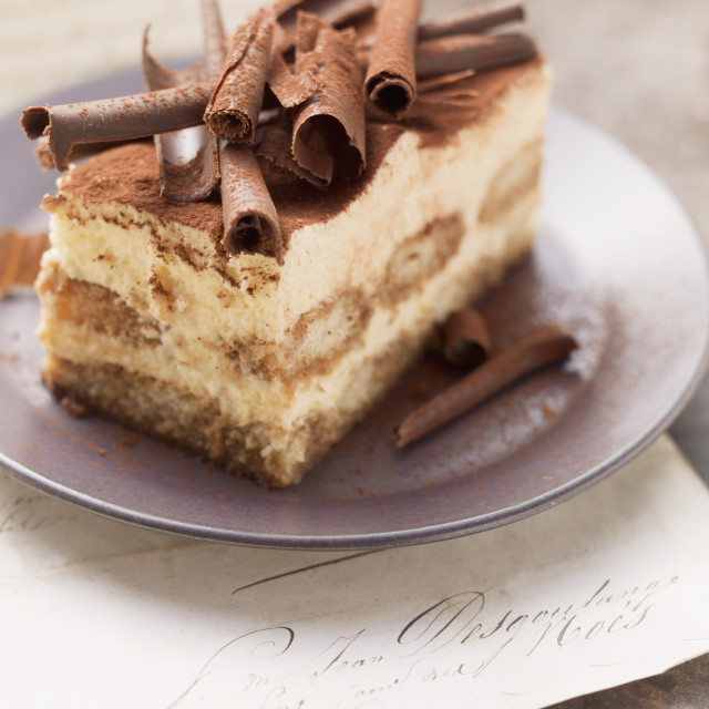 """A piece of tiramisu cake topped with rolls of chocolate"" stock image"