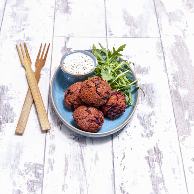 """Beetroot falafel with yoghurt and rocket"" stock image"