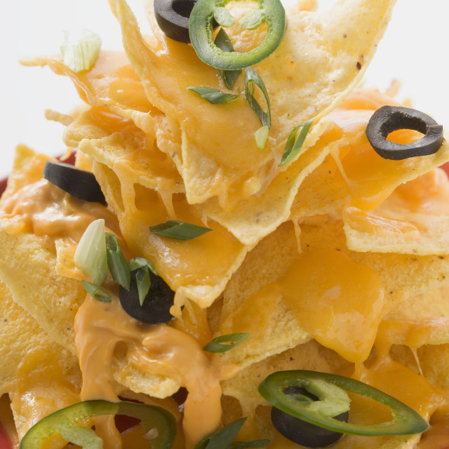 """Nachos with cheese, olives and chilli rings"" stock image"