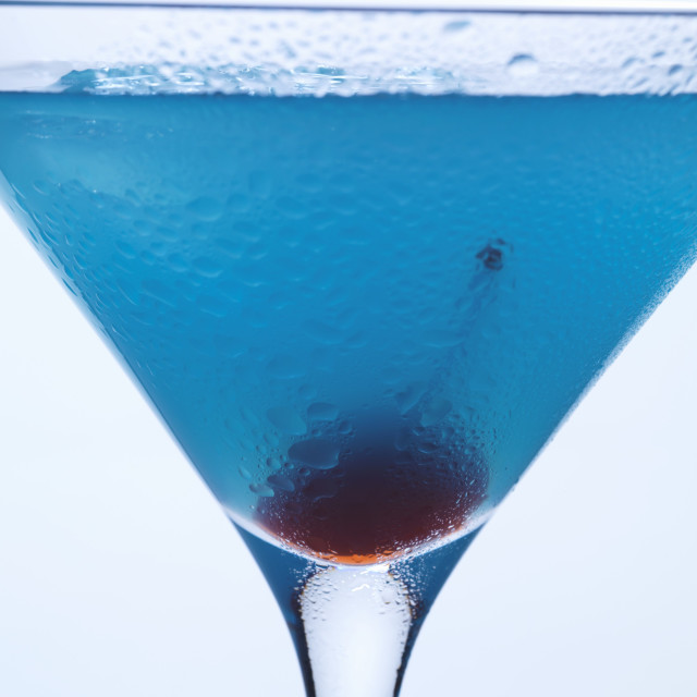 """Blue Curaçao cocktail with cocktail cherry (close-up)"" stock image"