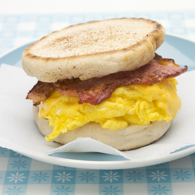 """English muffin filled with bacon, scrambled egg and cheese"" stock image"