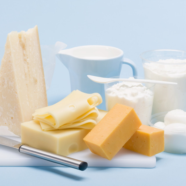 """Still life with hard cheese, fresh cheese and milk"" stock image"