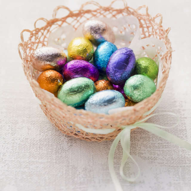 """An Easter basket with chocolate eggs"" stock image"