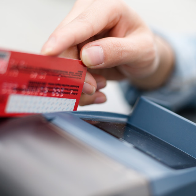 """""""Hand Swiping Credit Card In Store"""" stock image"""