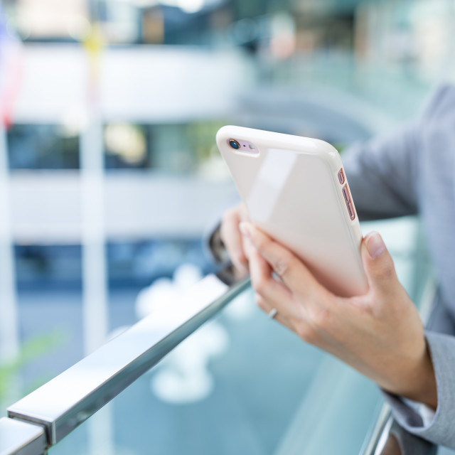 """Businesswoman sending sms on cellphone"" stock image"