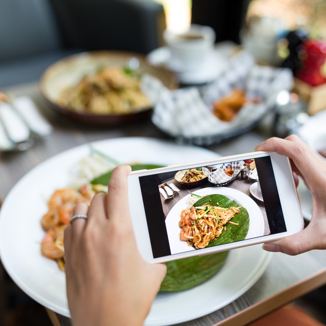 """""""Taking photo on dish with cellphone"""" stock image"""