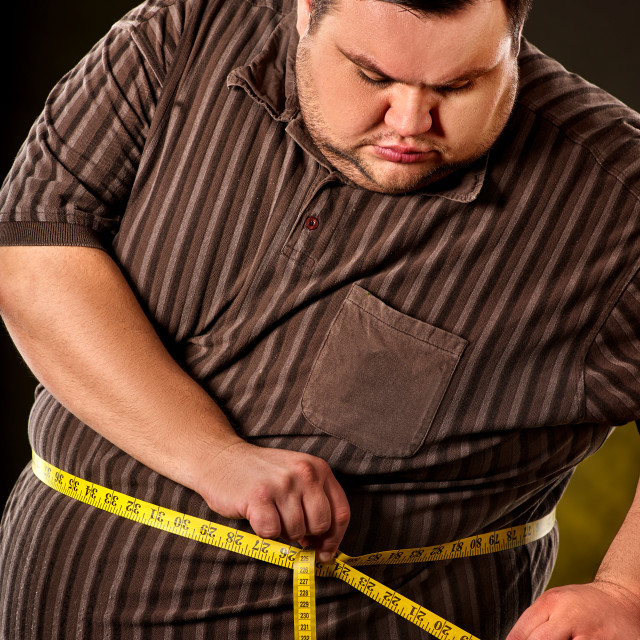 """Man belly fat with tape measure weight loss around body."" stock image"